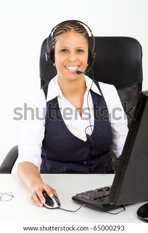 african american customer service consultant sitting at desk - stock photo