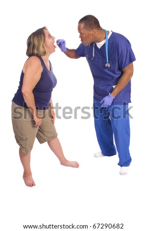 African American Doctor checking patients throat, isolated on white - stock photo