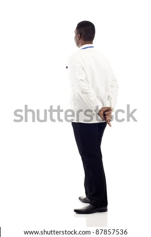 African American doctor from the back - looking at something over a white background