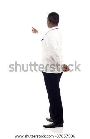 African American doctor from the back  - pointing at something over a white background - stock photo