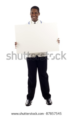 African American doctor showing medical sign billboard standing in full length isolated over white background