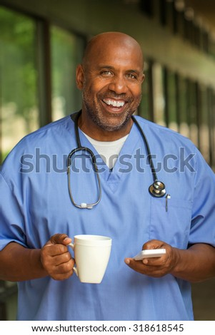 African American Doctor texting on the phone. - stock photo