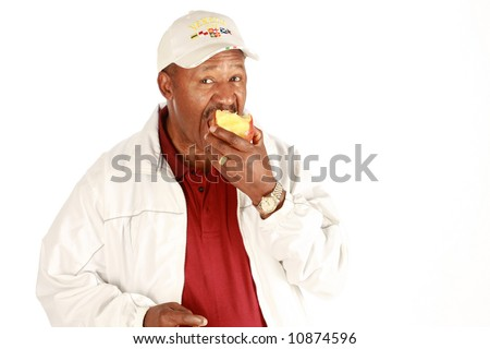 African american eating apple on pure white background