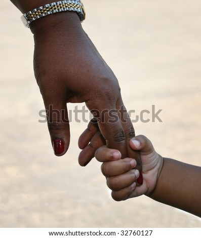 African-American family: child is holding mothers hand - stock photo