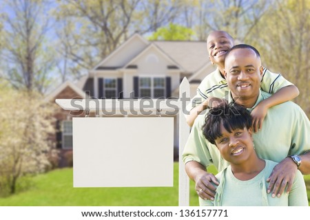 African American Family In Front of Blank Real Estate Sign and New House - Ready for Your Own Text. - stock photo