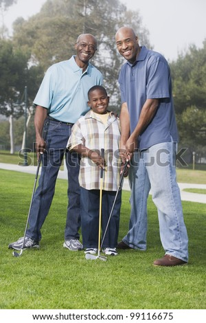 African American family playing golf - stock photo