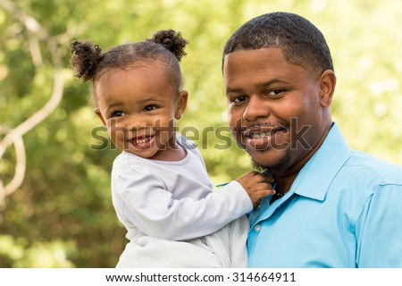 African American father and daughter.  - stock photo