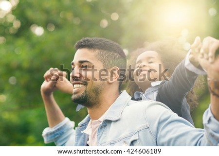 African American father and daughter having fun at the park