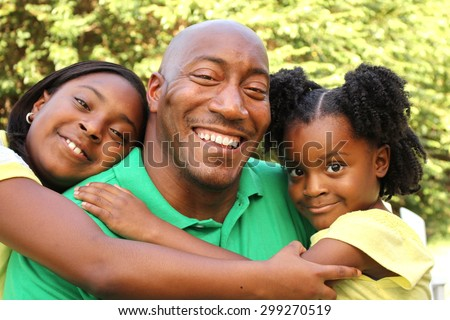 African American Father and Daughters - stock photo