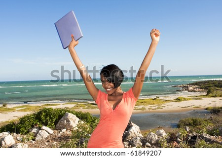 african-american female at beach with laptop - stock photo