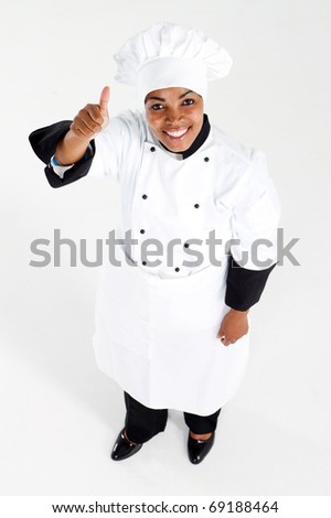 african american female chef giving thumb up - stock photo