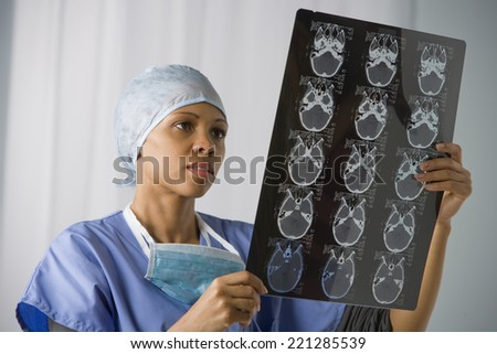 African American female doctor looking at x-ray - stock photo