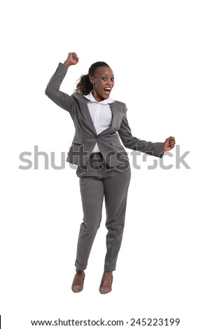 African American female executive with clenched fists celebrating success over white background - stock photo