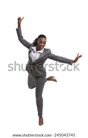 African American female executive with hands opened celebrating success over white background - stock photo