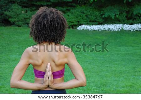 african american female in reverse namaste yoga pose - stock photo
