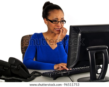 African American female office worker worried or scared - stock photo