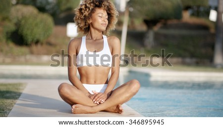 African american female posing by the pool in summer sunny day - stock photo