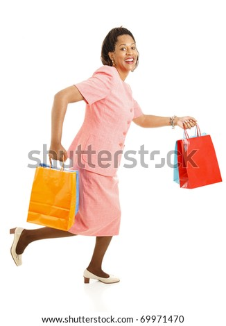 African-american female shopper running from one store to another for bargains.  Isolated on white. - stock photo