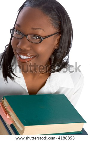 African-American Female Student by stack of books - stock photo