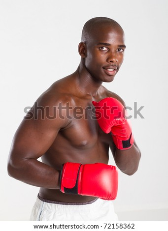 african american fit man with boxing gloves - stock photo