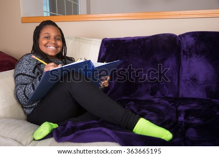 African American girl doing homework - stock photo