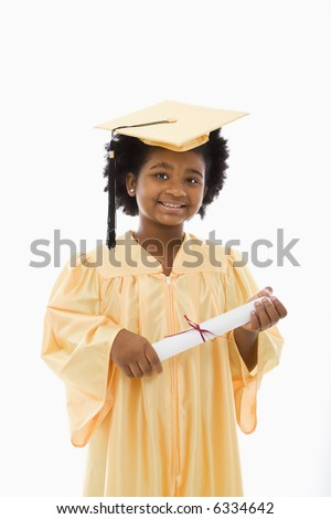 African American girl in graduation robe and hat holding diploma and smiling at viewer. - stock photo