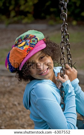 African American girl on the swing - stock photo
