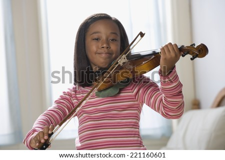 African American girl playing violin - stock photo