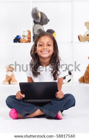 african american girl playing with laptop - stock photo