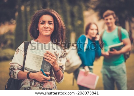 African-american girl student in a city park on summer day  - stock photo