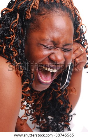 African American girl talking on cell phone laughing. - stock photo