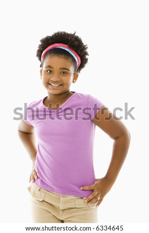 African American girl with hands on hips smiling at viewer. - stock photo
