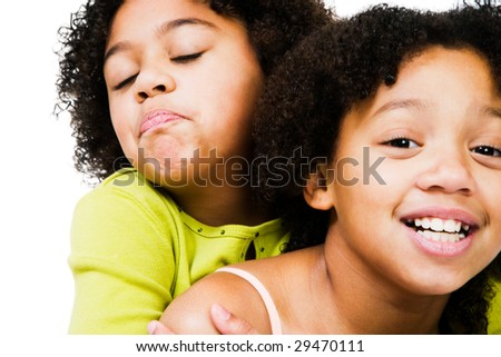 African American girls playing together isolated over white - stock photo