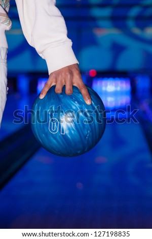 African American hand holding a bowling ball - stock photo