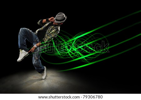 African American hip hip dancer with waves of light painting over dark  background