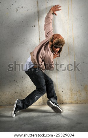 African American hip hop dancer over a grunge background - stock photo