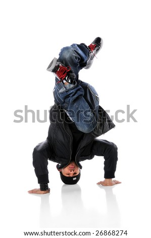 African American hip hop dancer performing a head stand - stock photo