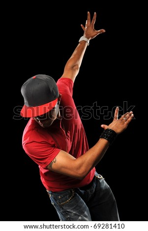 African American hip hop dancer performing isolated over black background