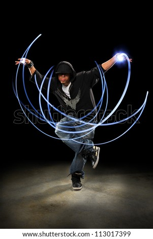 African American hip hop dancer performing with light painting - stock photo