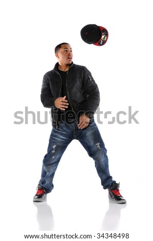 African American hip hop dancer throwing hat isolated over white - stock photo