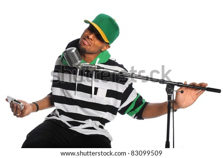 African American hip hop singer singing into vintage microphone isolated over white background - stock photo
