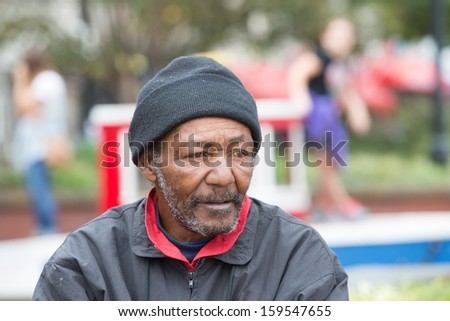 African american homeless man outdoors posing for portrait - stock photo