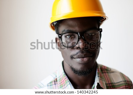 African American in a construction helmet - stock photo