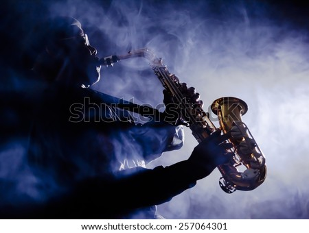African American jazz musician playing the saxophone - stock photo