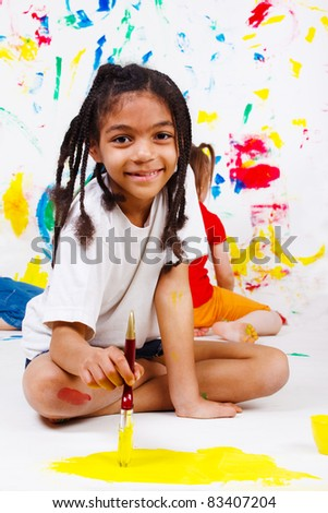 African american junior student painting