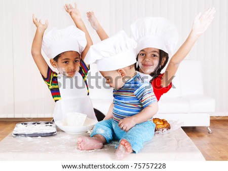 African american kids in cook costumes raising hands - stock photo