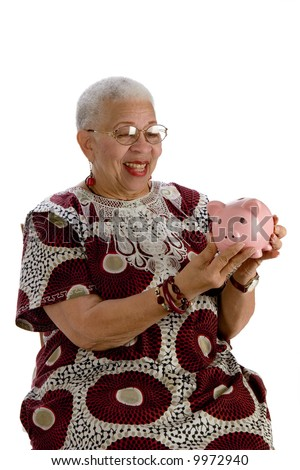 african american lady with piggy bank - stock photo
