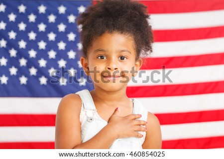 African-American little girl with American flag on a background