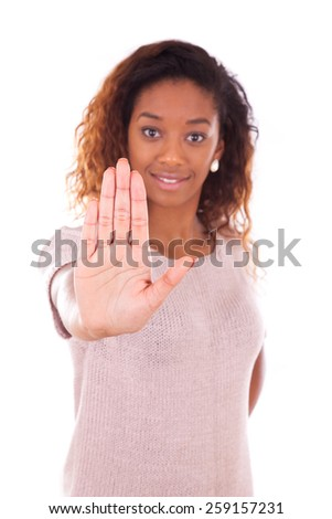 African american making stop sign with her hand palm isolated on white background - stock photo