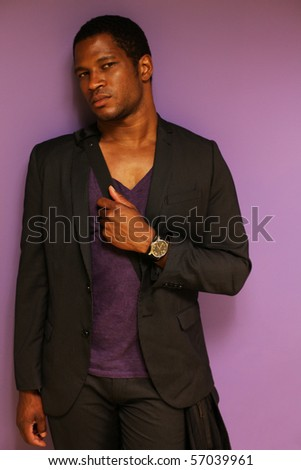 African American Male against Purple background - stock photo